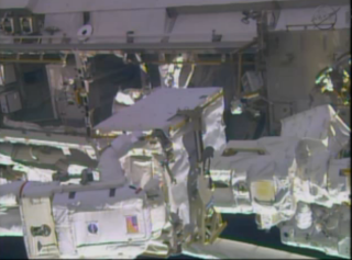 Astronaut Rick Mastracchio holds the failed pump module during a spacewalk Dec. 21.