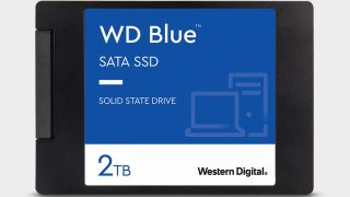 A WD Blue SATA SSD close up, top down view, on a grey background.