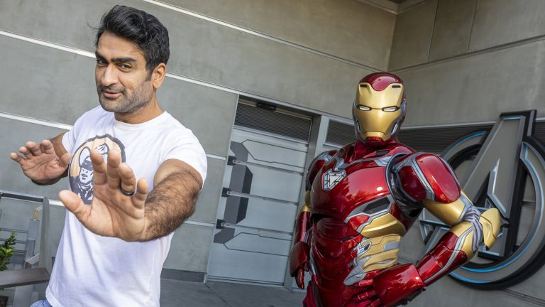 Kumail Nanjiani posing with Marvel's Iron Man