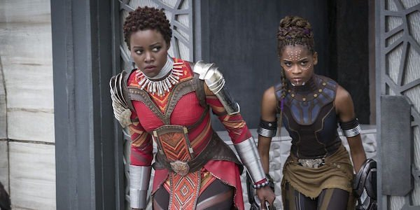 Lupita Nyong'o as Nakia in Dora Milaje costume and Letitia Wright as Shuri in full costume in Black