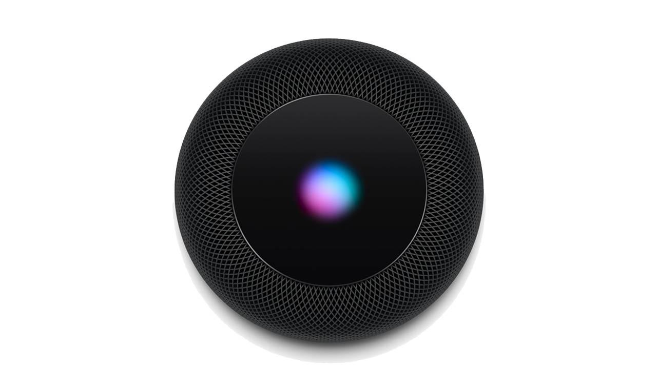 a bird-eye view of the apple homepod smart speaker showing the siri light lit up