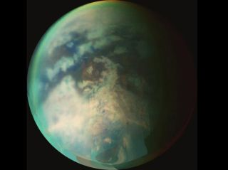 Titan's surface is difficult to see through the thick haze of its atmosphere. Scientists suspect the moon may have dust devils, just like Earth and Mars.