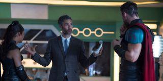 Taika Waititi directing Chris Hemsworth and Tessa Thompson