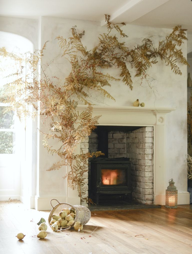 fall flower and foliage display around a mantle