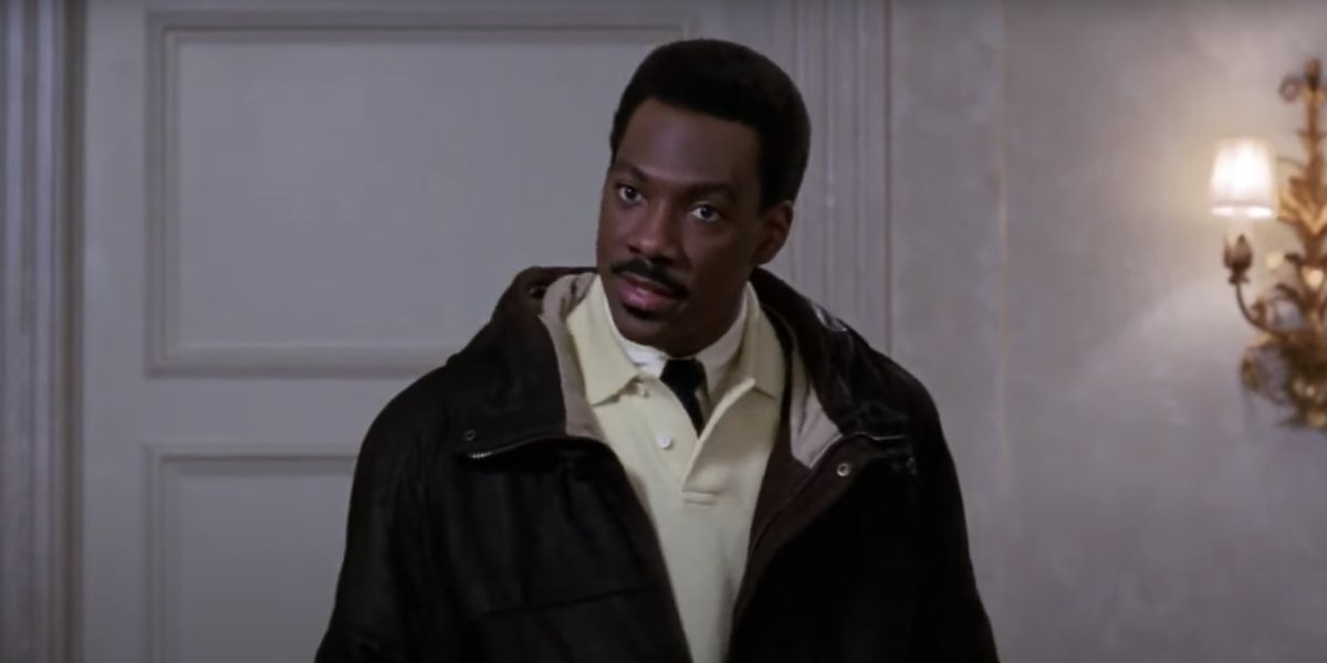 Eddie Murphy as Prince Akeem in Coming to America