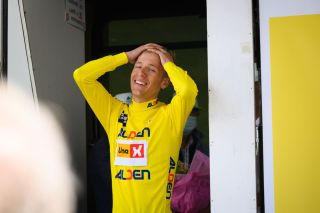 Tobias Halland Johannessen celebrates on the podium after winning the Tour de l'Avenir