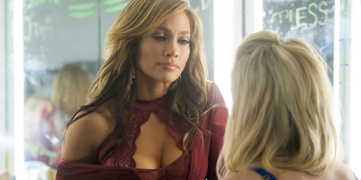 Hustlers Ramona (Jennifer Lopez) has a conversation with Annabelle (Lili Reinhart) in a dressing roo