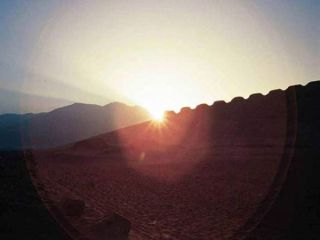 The rise of the sun is seen at a 2,300-year-old structure in Peru during the June solstice in 2003.
