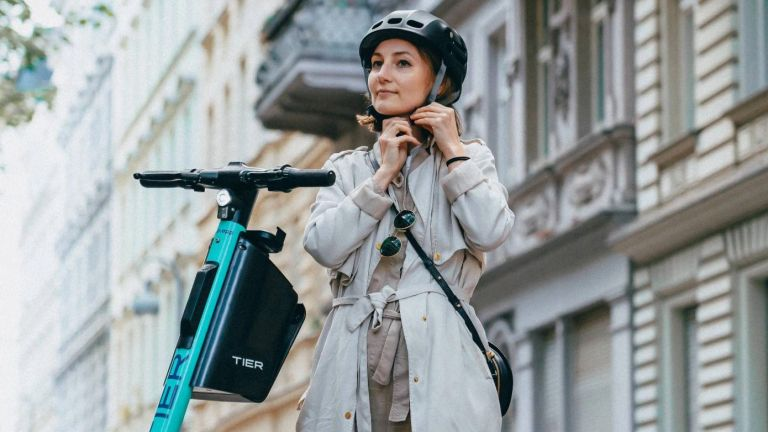 This new electric scooter comes with an integrated folding helmet!