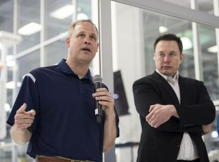 NASA Administrator Jim Bridenstine (left) and SpaceX CEO Elon Musk speak to the press at SpaceX Headquarters in Hawthorne, Calif. on Oct. 10, 2019.