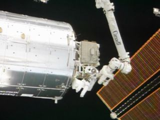 Mission Specialist Steve Bowen works outside the International Space Station during the second STS-133 spacewalk.
