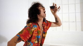 Bon Scott, posed, studio, drinking glass of wine
