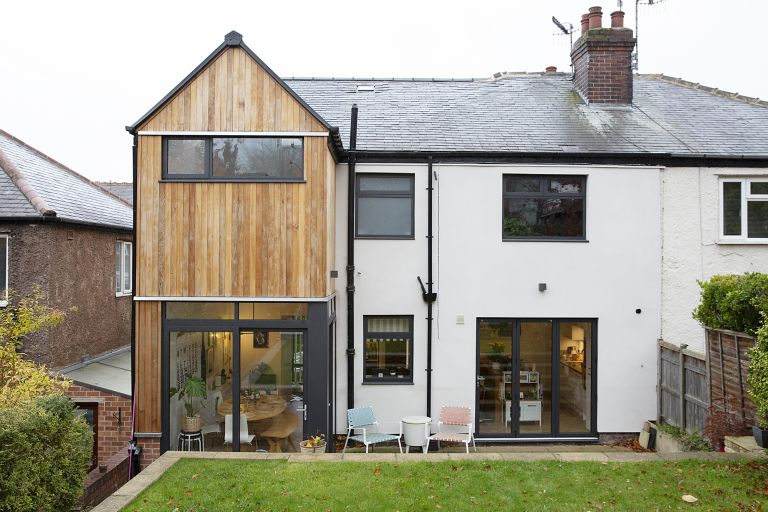 home insurance: The rear exterior of the house with the new two-storey extension clad in wood