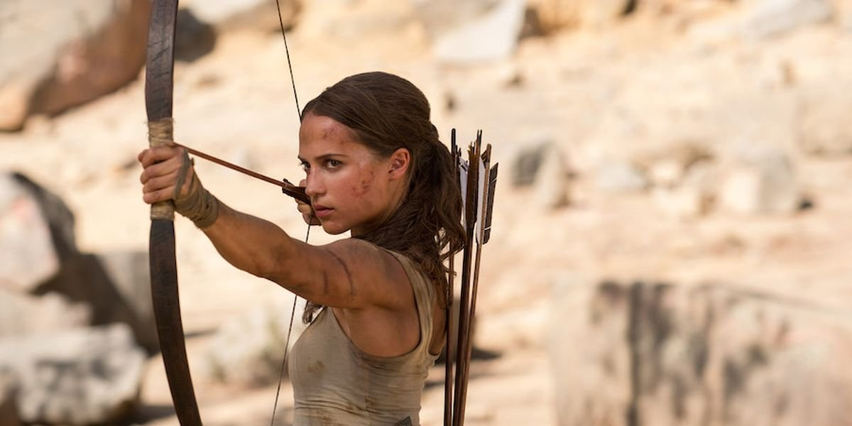 Alicia Vikander with a bow and arrow in Tomb Raider