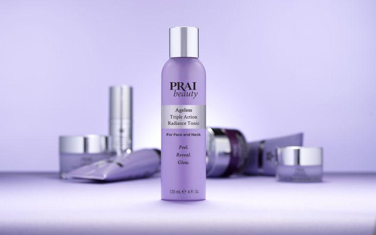 bottle of prai radiance tonic on purple background