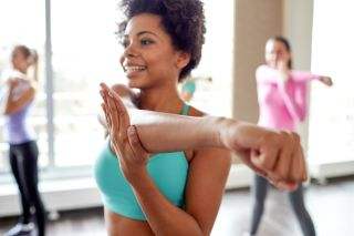 Women stretching in exercise class.
