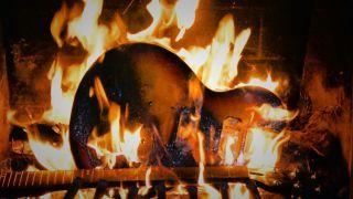 Guitar yule log burning on fire