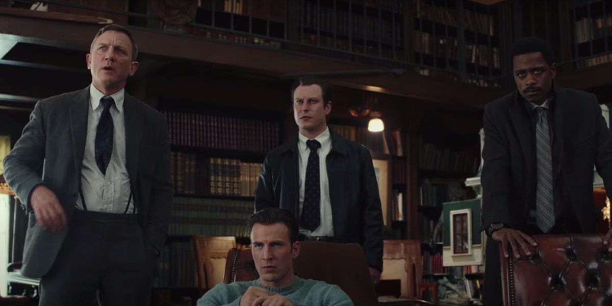 Knives Out Daniel Craig, Noah Segan, and Lakeith Stanfield circled behind Chris Evans