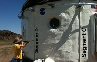 An air rifle is used to test the NASA Habitat Demonstration Unit.