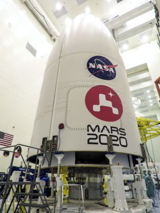 NASA's Mars 2020 Perseverance rover is encapsulated in its Atlas V rocket payload fairing at NASA's Payload Hazardous Servicing Facility at the Kennedy Space Center in Florida on June 18, 2020.