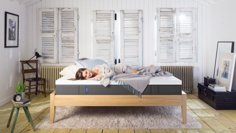 Emma mattress review: mattress on bed with woman asleep