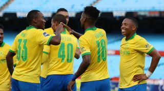 Themba Zwane celebrates his goal with teammates