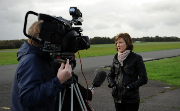 Fiona Bruce reporting on location