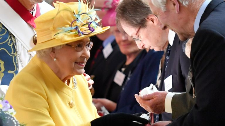 Queen Elizabeth II distributes the Maundy money during the Royal Maundy Service at St George's Chapel in Windsor, west of London on April 18, 2019.