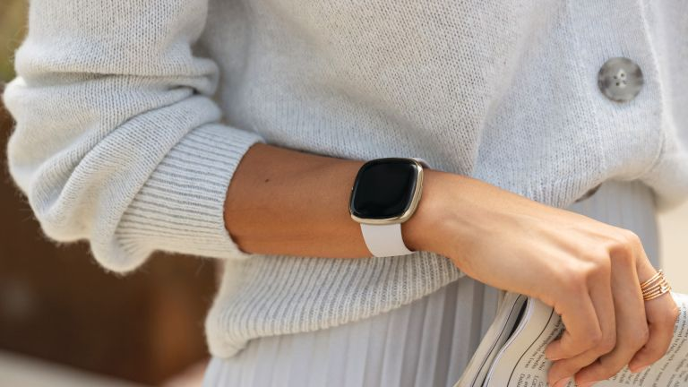 Fitbit street style lunar watch on womans wrist