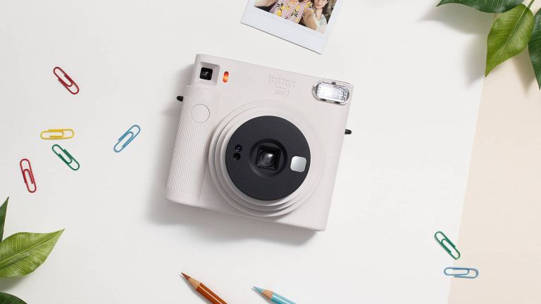 The best Christmas gifts for 2020: Fujifilm Instax SQUARE SQ1 on white surface with paperclips