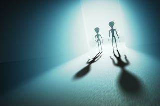 silhouettes of aliens.