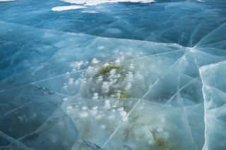 frozen bubbles of methane lake baikal