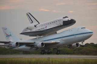Space shuttle Endeavour, atop its Shuttle Carrier Aircraft, takes off on NASA's last-ever ferry flight from the Kennedy Space Center in Florida on Sept. 19, 2012.