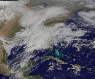 Two low pressure areas coming together on March 13, 2017 will likely cause a heavy snowstorm to hit New England overnight. The clouds associated with those low pressure systems were imaged by NOAA's GOES-East satellite.