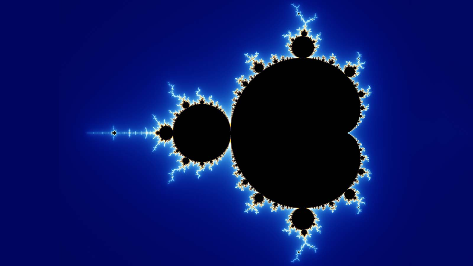A geometric fractal known as a Mandelbrot set drawn in black against a deep blue background