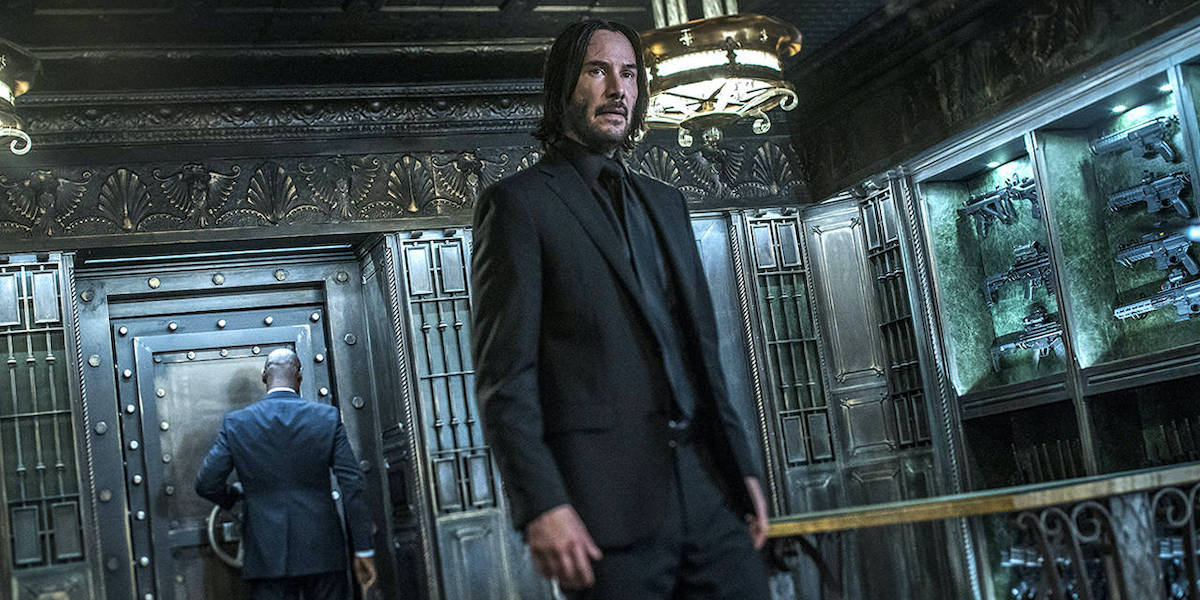 Black suited Keanu Reeves in Continental hotel in John Wick 3