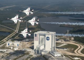 President Donald Trump wants a new Space Force branch of the U.S. military, but it reopens an old argument about military uses in space. Here, the U.S. Air Force Thunderbirds fly over NASA's Kennedy Space Center in Florida with retired NASA astronaut and