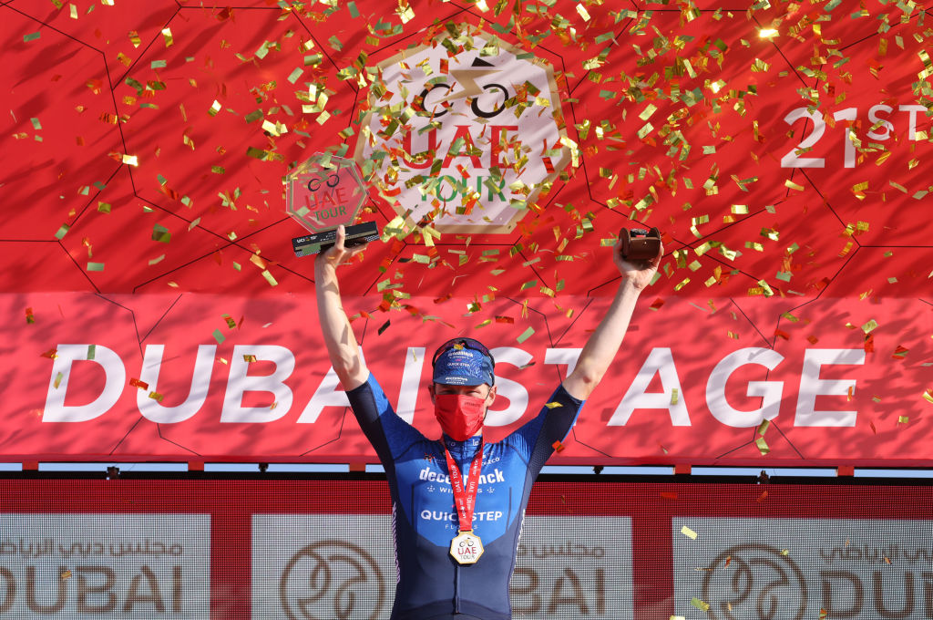 Sam Bennett of Deceuninck Quick Step celebrates on the podium after winning the sixth stage of the UAE Cycling Tour From Dubai Deira Islands to Dubai Palm Jumeriah on February 26 2021 Photo by Giuseppe CACACE AFP Photo by GIUSEPPE CACACEAFP via Getty Images