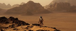 """Mark Watney contemplates the deserted landscape in the film """"The Martian."""""""
