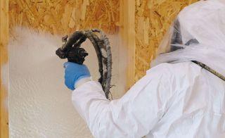 Man applying spray foam insulation