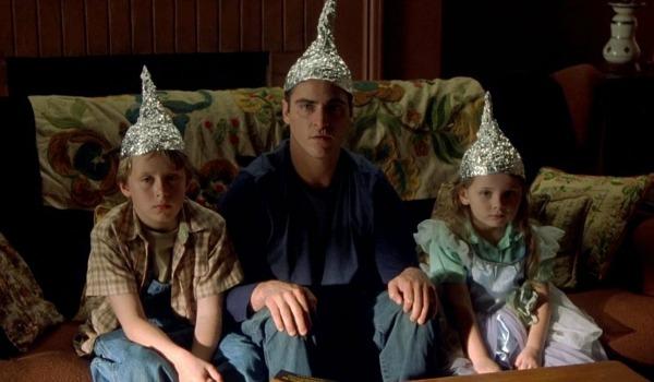 Joaquin Phoenix, Rory Culkin, Abigail Breslin wearing tin hats