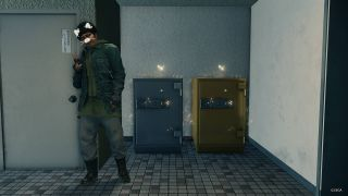 Yakuza: Like A Dragon - Nanba posing with a silver safe and gold safe