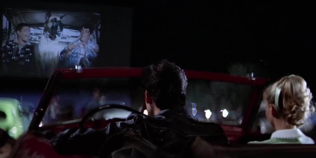 John Travolta and Olivia Newton John in Grease Drive-In