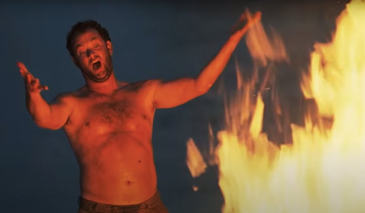 Cast Away Tom Hanks shouting in front of a bigger fire