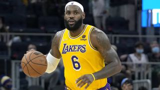 LeBron James of the Los Angeles Lakers dribbles the ball during an NBA live stream