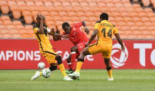 Dramane Nikiema challenges Ramahlwe Mphahlele for the ball