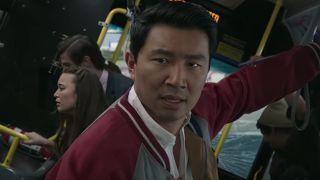 Simu Liu as Shang-Chi on San Francisco bus in Legend of the Ten Rings action sequence.
