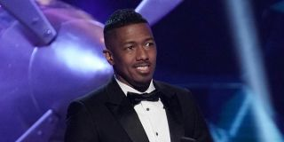 nick cannon hosting the masked singer in a tux
