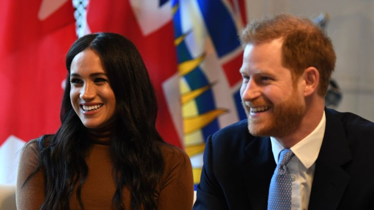 Prince Harry, Duke of Sussex and Meghan, Duchess of Sussex smile during their visit to Canada House