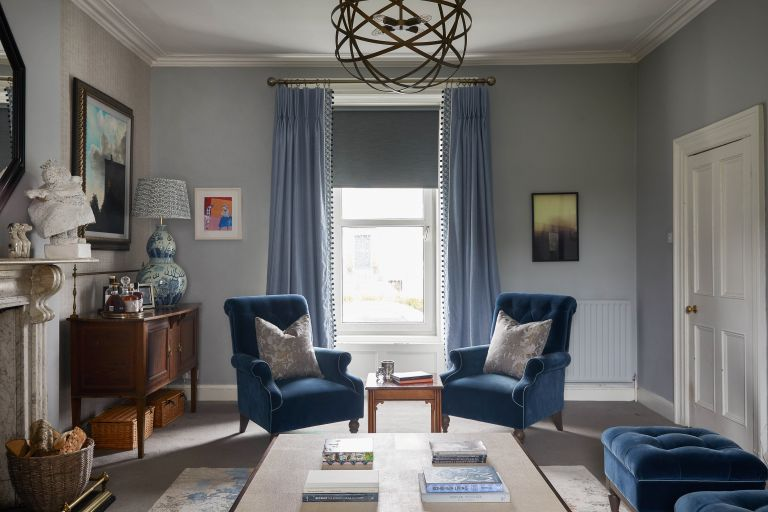 blue living room with blue armchairs blue curtains and blue window blind